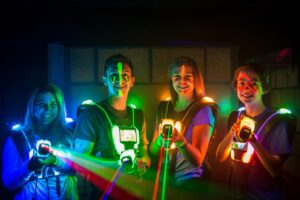 Laser Tag players in neon lighting